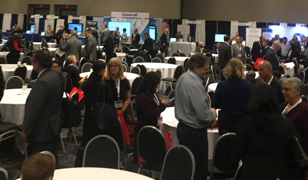 attendees networking with each other and with exhibits