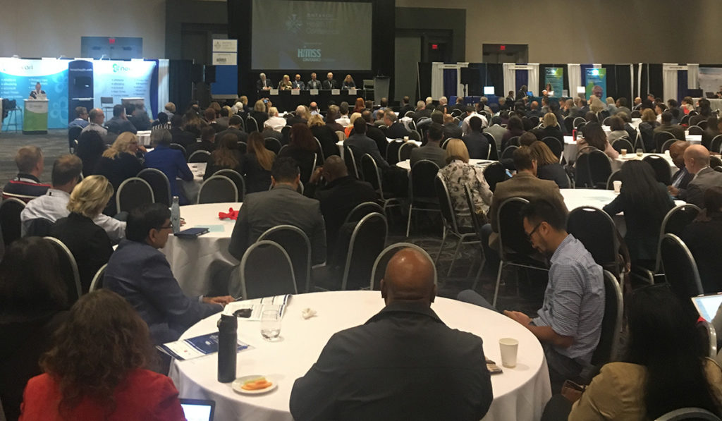 attendees listen in on the afternoon keynote panel session