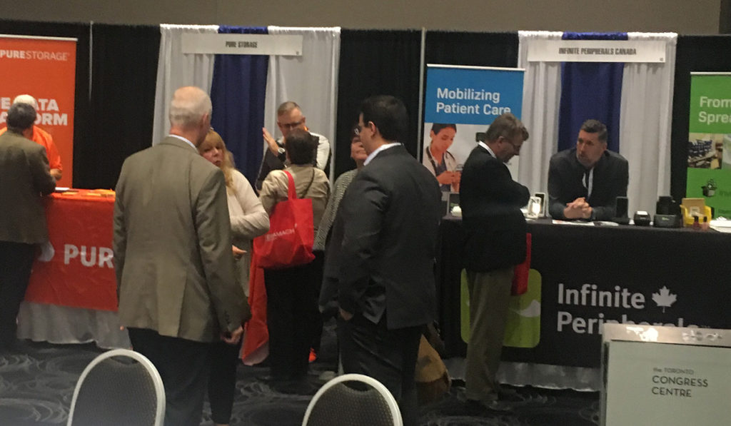 attendees networking with exhibits