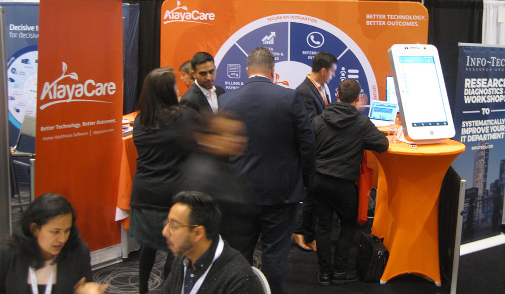 Attendees networking with exhibitors and other attendees